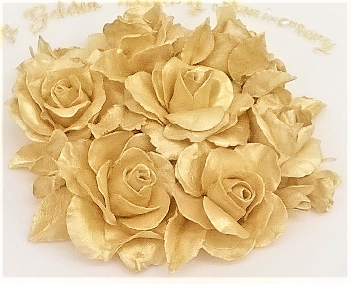 Gold sugar roses on Testimonials Page for Cocoa & Whey Cakes